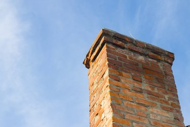 Old chimney and blue clear sky.