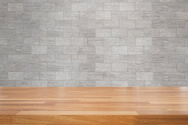 How to Put Tiles on Concrete Walls