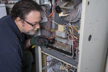 Technician Checking a Gas Furnace