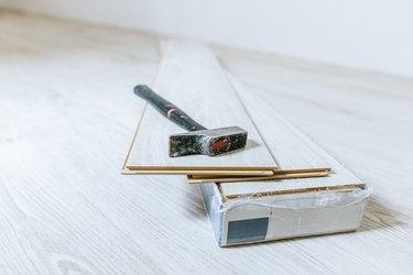 Hammer on sheets of wood laminate floor