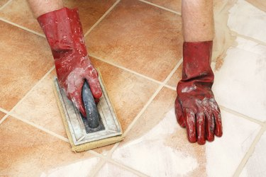 Removing excess grout from the tiles