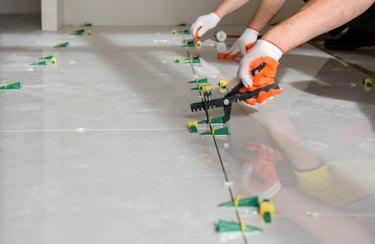 Installing a large ceramic tile.