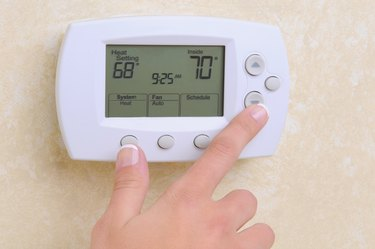 Closeup of Hand and Thermostat