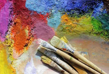 oil paints palette and paint brushes