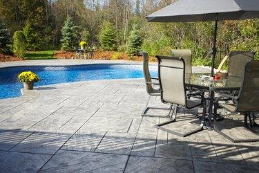 Upscale backyard with swimming pool