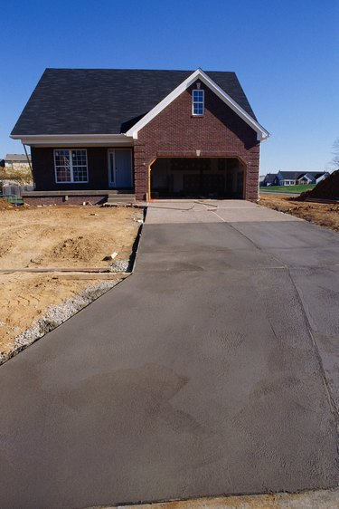 Concrete driveway leading up to new home