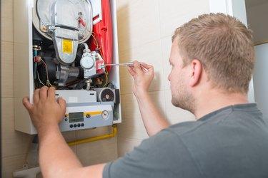 Technician repairing Gas Furnace