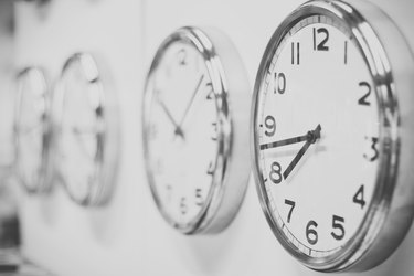 Clocks hanging on the white wall