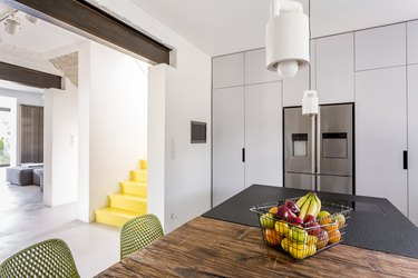 White scandi kitchen with tables