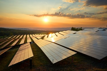 Photovoltaic panels of solar power station at sunset.