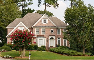 Traditional Brick Home with Blooming Crepe Myrtle