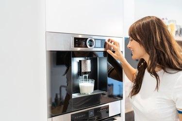 Woman and coffee machine