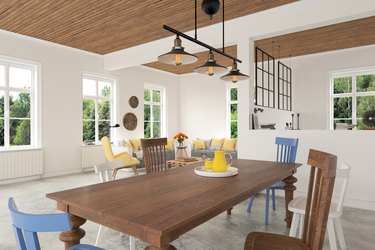 Wooden dining table with chairs close up