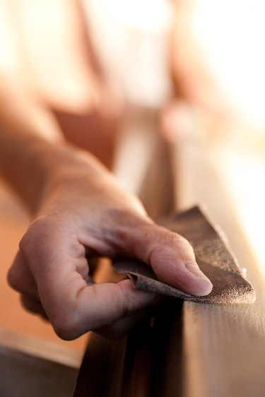 Hand of a woman sanding.