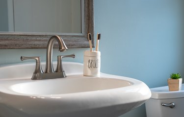 Earth friendly bamboo toothbrushes on the bathroom sink