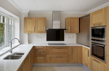 oak fitted apartment kitchen