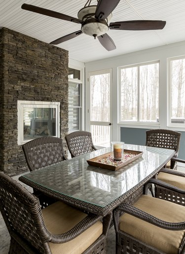Wicker dining table and chairs in dining room.