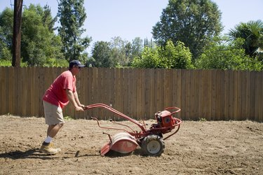 Man using landscaping machine outdoors