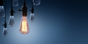 Innovation And Leadership Concept - Glowing Bulb lamp