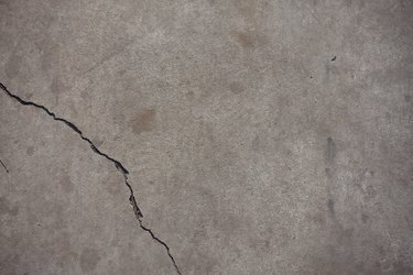 Fissure on light grey concrete slab from above