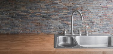 Wood Kitchen counter and stone backsplash tiles