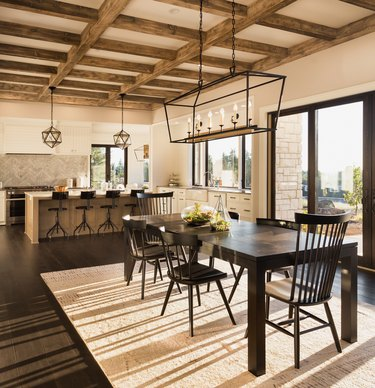 beautiful dining room and kitchen in new luxury home with island and pendant light fixtures