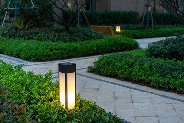 lighted light near sidewalk