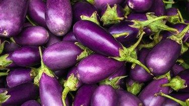 Close-up of several purple eggplants