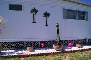 Mobile home back yard with decorative block skirting.