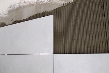 Wall ceramic tiles installation on mortar glue.