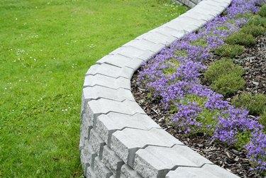 White granite garden ornament with flowers inside
