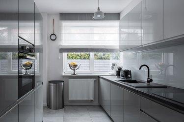 Narrow kitchen with modern furniture