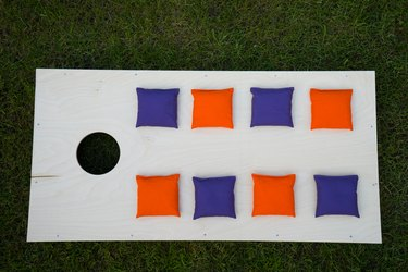 Cornhole Board Flat Lay with beanbags on grass