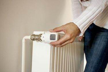 One hand adjusting thermostat valve