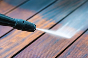 cleaning terrace with a pressure washer