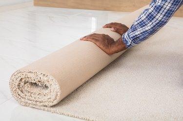 Worker's Hands Rolling Carpet