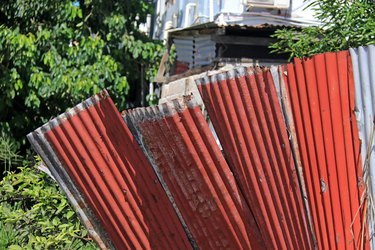Old corrugated tin sheets used as fence in a developing country