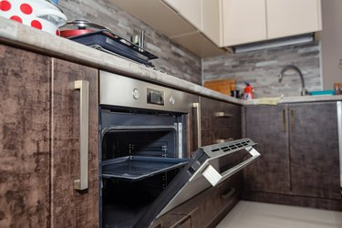 Modern kitchen interior in wenge colors with built-in appliances