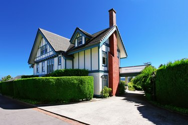 Craftsman style American house exterior with white and blue trim.