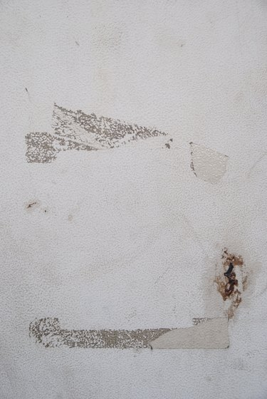 Dirty old white wall with tape marks and grime