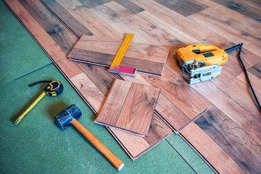 Carpentry tools on laminated floor.