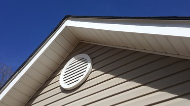 Closeup of a roof vent on a house.