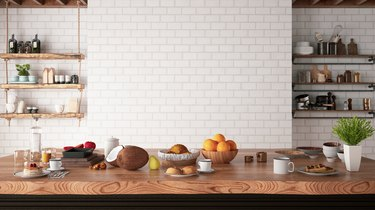 Kitchen Counter with Foods and Empty White Brick Wall