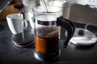 Hot water pouring into a French press coffee maker