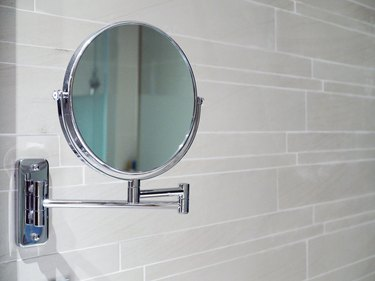 Magnifying glass inside bathroom of modern and convinience hotel.