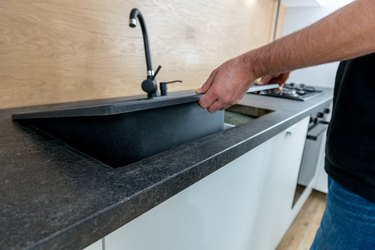 Installing a new ceramic sink in kitchen