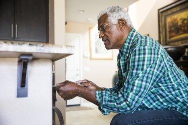 Senior Black Man Home Repairs