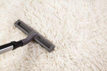 Vacuum cleaner nozzle on shag carpet