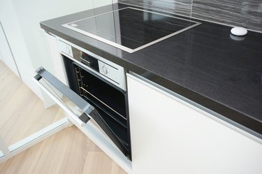 Modern kitchen interior with black and white electric oven, electric stove.