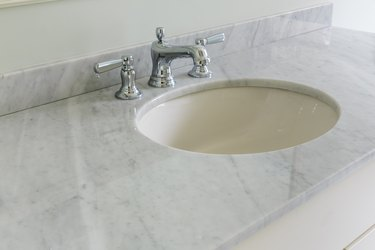 Light bathroom with marble counter top
